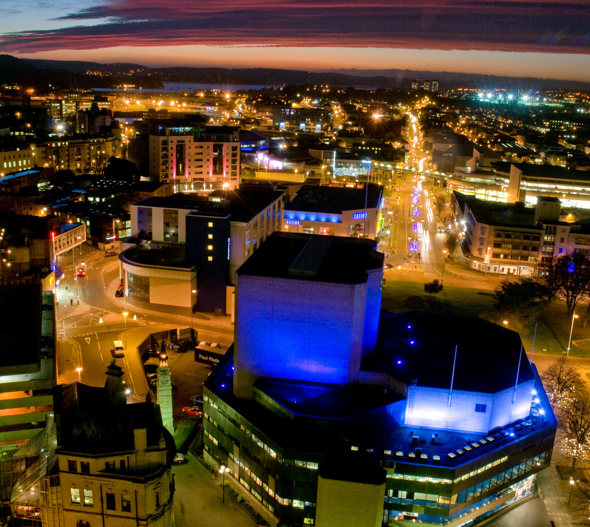 image of Plymouth buildings lit up at night