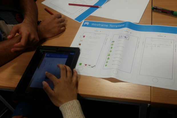 image of student writing on a wireframe template document