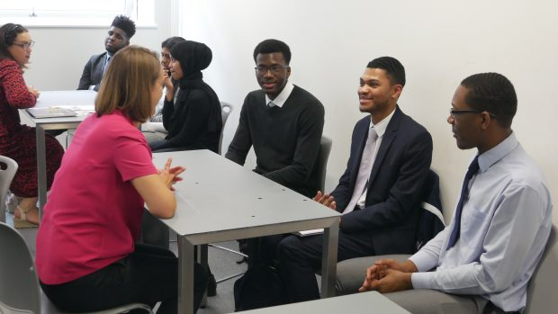 Students at an industry networking event.