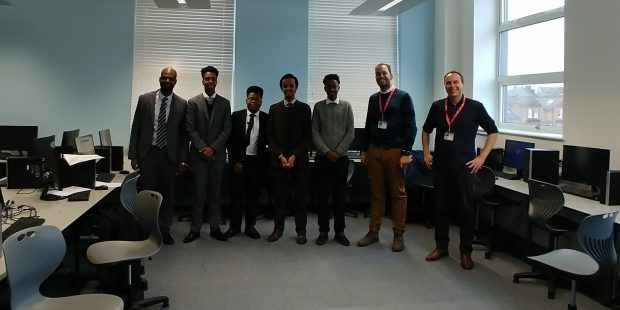 Image of students, teacher and visitors from DCMS at the UTC.